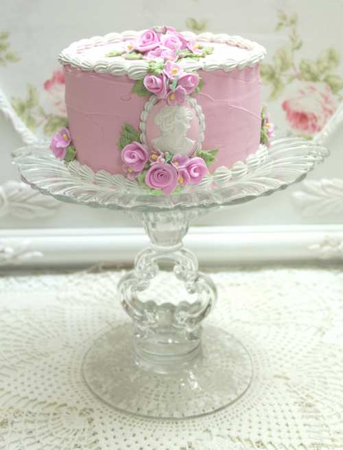 Glass Stem Cake Plate and Cake I-pink cameo cake, glass cake plate, glass plate and pink cake